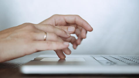 Closeup of female hands typing on laptop keyboard Footage