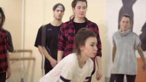 Young people have a dance rehearsal in light studio Footage
