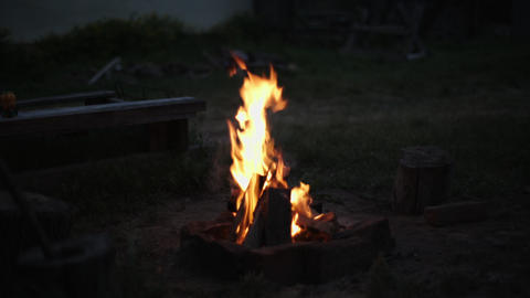 Campfire is lit in the evening Footage
