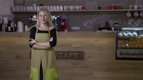 Hard working young blonde woman finally opens her own cafe business and stands Footage