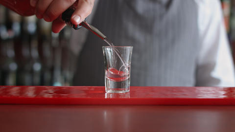 Bartender pours one shot of alcohol Footage