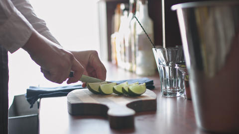 Bartender cutting limes Footage
