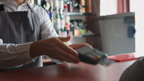 Accepting customer's payment with credit card Stock Video Footage