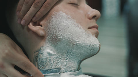 Barber shaves the beard of the client Footage