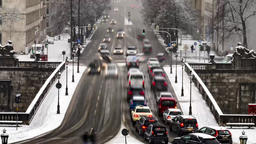 Traffic is driving through the snow during the snow storm - Aerial Time lapse Footage
