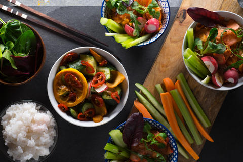 Rice, pickled vegetables in bowls and chopsticks close-up. Asian cuisine Photo