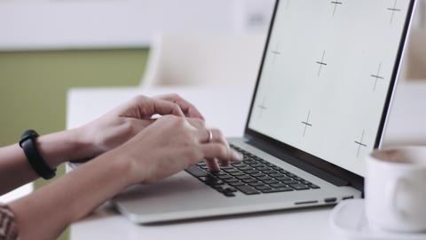 Crop female hands using laptop Footage