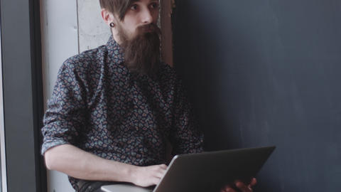 Hipster using digital notebook Live Action