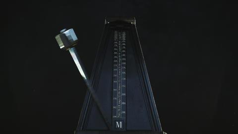 Vintage metronome beats the rhythm Live Action