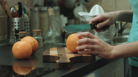 Woman cut oranges Footage