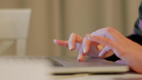 Girl in camouflage clothes works with her fingers on the touchpad Footage