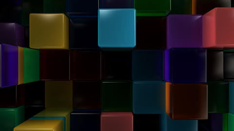 Wall of blue, green, orange and purple glass cubes フォト