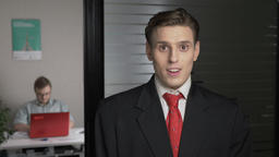 A young successful man in a suit shows an emotion of surprise, a portrait. Man Footage