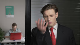Young businessman in suit doing facepalm. Man works on a computer in the Footage