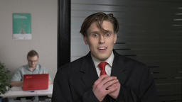 Young successful man in a suit shows scared, frightened, afraid, fear. Man works Footage