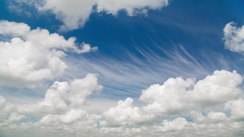 Time lapse of movement fluffy clouds in the bright blue sky Live Action