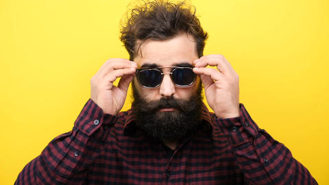 Hipster puts his glasses on the face Footage
