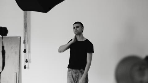 Young Guy Posing For The Camera In The Studio