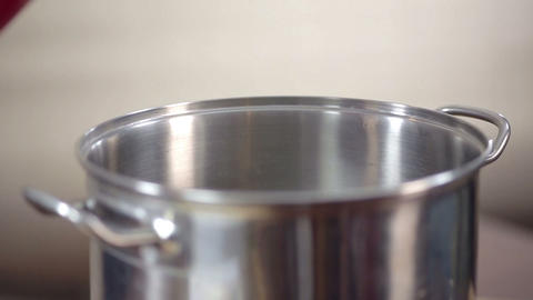 Close-up, detail of water being poured con saucepan Live Action