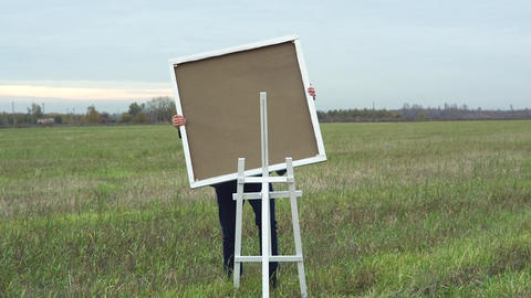 Artist Is Preparing To Paint A Picture stock footage