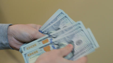 Man's hands counting money dollar bills.Paying or counting money. Close up of do Footage
