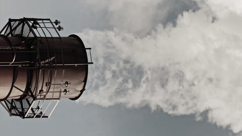 Stream of dark smoke from the chimney of factory Footage