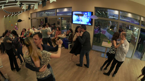 Casual couples dancing tango during milonga Footage