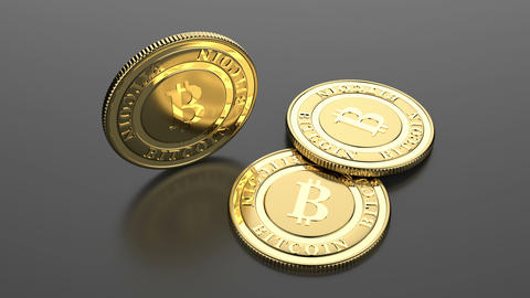 Two lying and one rotating golden bitcoins CG動画素材