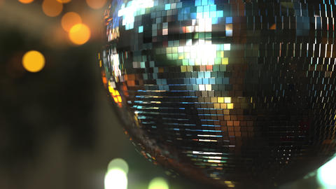 Turning mirror disco ball against bokeh background. Joy, dancing or party Footage