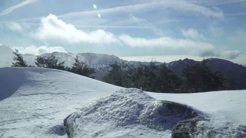 Sunny landscape with snowy mountain clouds Footage