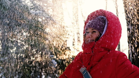 Pretty girl throws up the snow and laughing, slow motion Footage