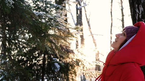 A beautiful girl enjoys the fresh air in the winter forest, exhales couples from Live Action