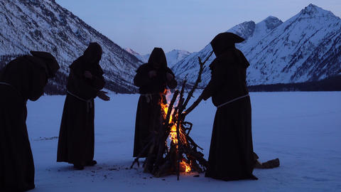 monks are warming near fire in winter Footage