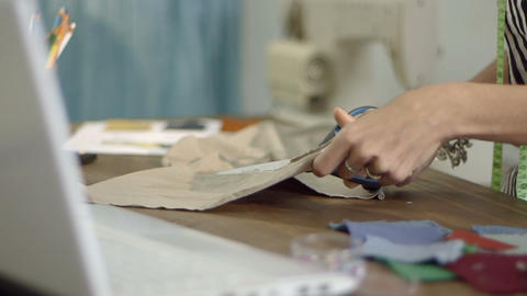 Fashion designer cutting fabric Footage