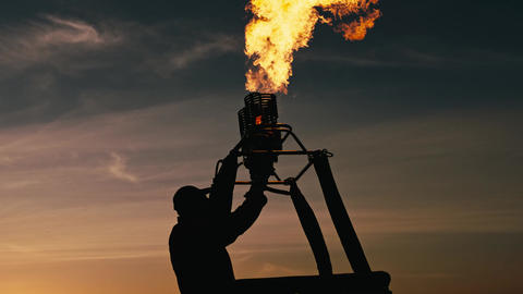 Gas flame to fill air balloon with hot air Live Action
