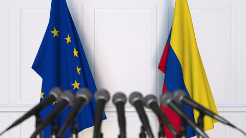 Flags of the European Union and Colombia at international press conference Live Action