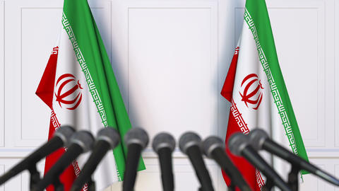 Iranian official press conference. Flags of Iran and microphones. Conceptual Footage