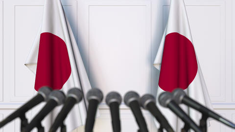 Japanese official press conference. Flags of Japan and microphones. Conceptual Footage