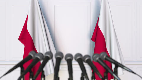 Polish official press conference. Flags of Poland and microphones. Conceptual Footage