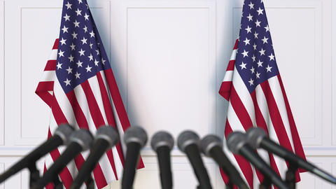 American official press conference. Flags of the United States and microphones Footage