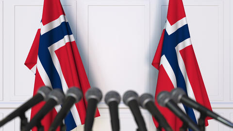 Norwegian official press conference. Flags of Norway and microphones. Conceptual Footage