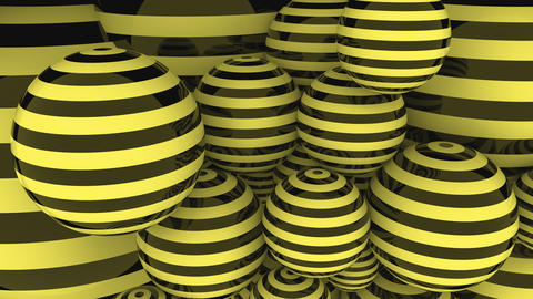 Black and yellow striped balls loopable motion background Footage