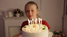 Happy children with birthday cake Footage