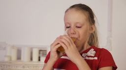 Little girl drinking juice Footage