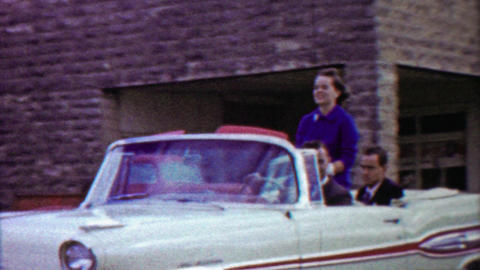 1959: Women beauty queens riding convertible car summer parade Footage