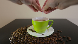 Man stirs sugar in a Cup of coffee. hands closeup with cup of coffee Footage
