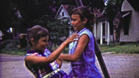 1959: Sisters rivalry colorful dress fighting fly swatter battery abuse Footage