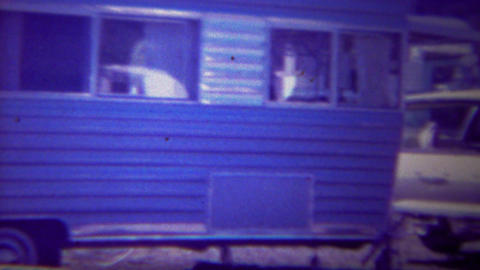 1956: Motorhome recreational vehicle trailer towed Ford station wagon car Footage