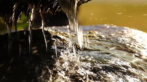 water running over mossy rocks Footage