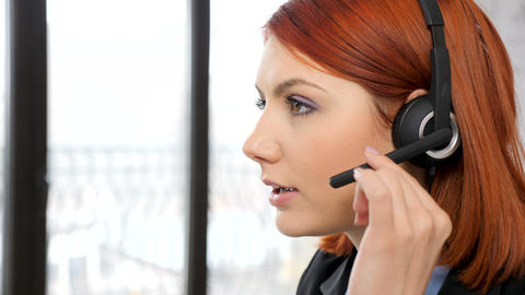 Close up woman head talking on the headset Footage